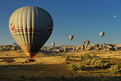 Cappadocia Photograph - Hot Air Balloon Landing In Farm Fields At Love Valley And Uchisa by Reimar Gaertner