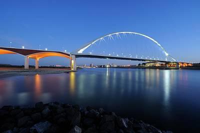 Illuminated Bridge De Oversteek In Nijmegen Across The Waal River At Dusk Print by Merijn Van der Vliet
