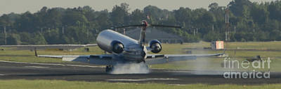 Star Alliance Airlines Photograph - Jet Plane Landing On Runway With Tires Smoking by David Oppenheimer