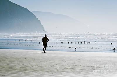 Jogger At Morro Bay Print by Bill Brennan - Printscapes