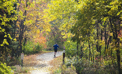 Jogger On Nature Trail In Autumn Print by Lynn Hansen