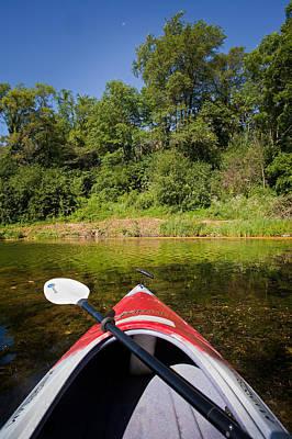 Kayak On A Forested Lake Print by Steve Gadomski