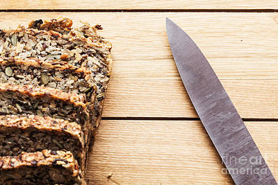 Tasty Photograph - Knife And Wholemeal Bread On Wooden Table by Michal Bednarek