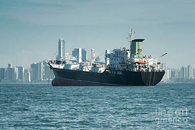 Panama Photograph - Large Cargo Ship Anchored And The City Skyline At The Background, Panama  by Dani Prints and Images