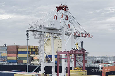 Transportation Photograph - Large Harbour Crane Loading Containers On A Large Cargo Vessel  by Dani Prints and Images