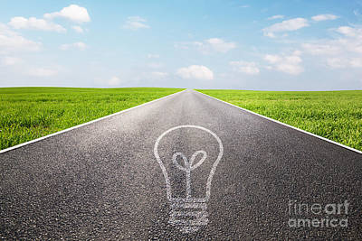 Asphalt Photograph - Light Bulb Symbol On Long Empty Straight Road by Michal Bednarek