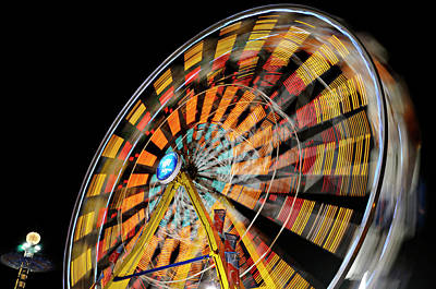 Toronto Photograph - Light Streaks From The Spinning Ferris Wheel And Swing At Night  by Reimar Gaertner