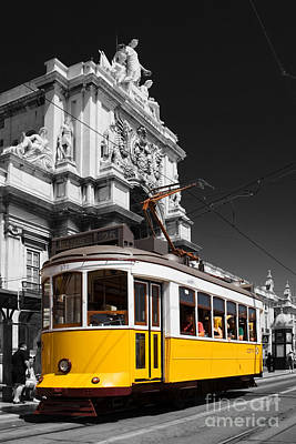 Lisbon's Typical Yellow Tram In Commerce Square Print by Jose Elias - Sofia Pereira