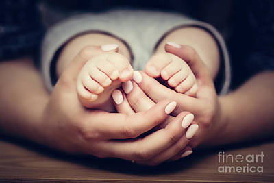 Feet Photograph - Little Baby Feet In Mother's Hands. Child Care, Feeling Safe, Protect. by Michal Bednarek