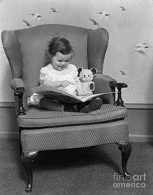 Little Girl With Picture Book, C.1930s Print by H. Armstrong Roberts/ClassicStock