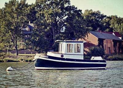 Water Vessels Photograph - Little Tugboat 2.0 by Michelle Calkins
