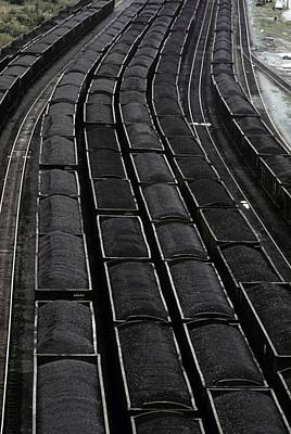 Loaded Coal Cars Sit In The Rail Yards Print by Everett