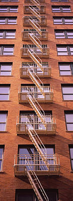 Frame House Photograph - Low Angle View Of Fire Escape Ladders by Panoramic Images