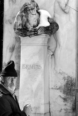 Brahms Photograph - Man At The Grave Of Johannes Brahms by Todd Fox
