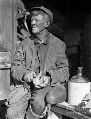 Woodcarving Photograph - Man Carving Duck Decoy, C.1920-30s by H. Armstrong Roberts/ClassicStock
