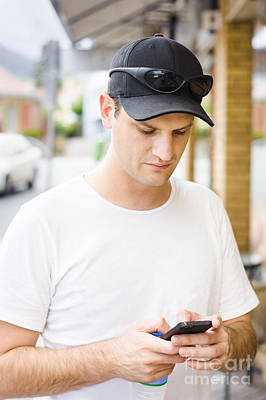 Man Engaging In Communication On Smart Phone Print by Jorgo Photography - Wall Art Gallery