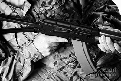 Man In Combat Fatigues Holding Aks-47u Close Quarter Combat Kalashnikov Rifle Print by Joe Fox