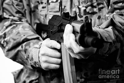 Man In Combat Fatigues Holding Aks-47u Close Quarter Combat Kalasknikov Rifle Focus On Safety Select Print by Joe Fox