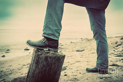 Adult Photograph - Man In Jeans And Elegant Shoes Leaning Against Trunk Tree On Wild Beach Looking At Sea by Michal Bednarek
