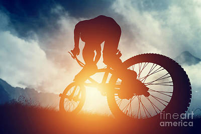Action Photograph - Man Riding A Bike In High Mountains At Sunset by Michal Bednarek