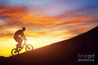 Aim Photograph - Man Riding A Bmx Bike Uphill Against Sunset Sky by Michal Bednarek