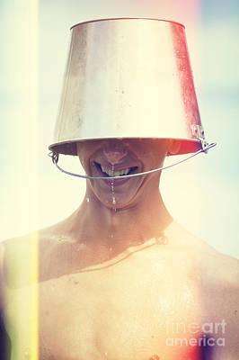 Water Play Photograph - Man Wearing Water Bucket On Head In Summer Heat by Jorgo Photography - Wall Art Gallery