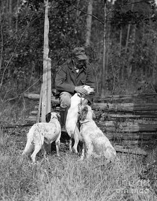 Senior Dog Photograph - Man With Hunting Dogs, C.1920s by H. Armstrong Roberts/ClassicStock