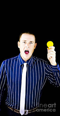 Man With Open Mouth Holding Yellow Bulb Print by Jorgo Photography - Wall Art Gallery