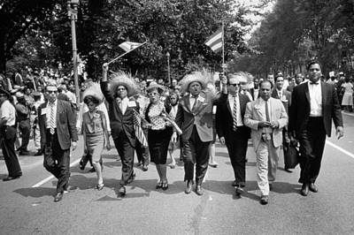 Marchers Wearing Hats Carry Puerto Rican Flags Down Constitution Avenue Print by Nat Herz