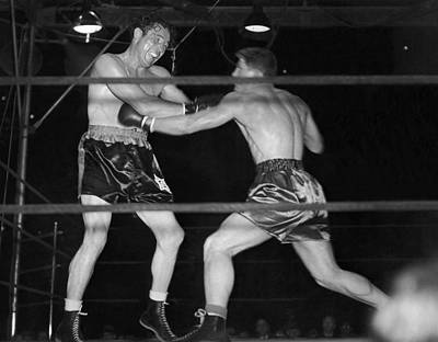 Boxing Gloves Photograph - Max Baer And Lou Nova Boxing by Underwood Archives