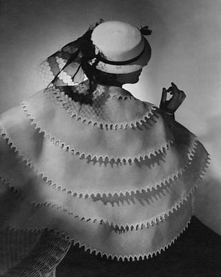 Ball Gown Photograph - Model Wearing A White Sailor Hat by Conde Nast