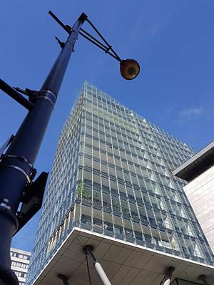 Manchester Photograph - Modern Lamppost And Building by Iordanis Pallikaras