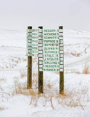 Snow Photograph - Montana Signpost by Todd Klassy