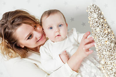 Woman Enjoying Life Photograph - Mother Plays With Her Baby Daughter. Portrait On Starry Wallpaper by Michal Bednarek