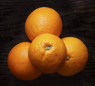 Naval Oranges On Wood Background Print by Donald Erickson