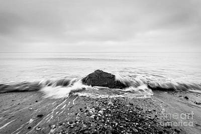 Sadness Photograph - Nostalgic Sea. Waves Hitting In Rock In The Center by Michal Bednarek
