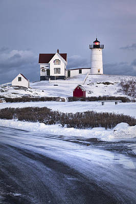 Nubble Lighthouse In The Snow Print by Eric Gendron