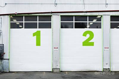 Numbers On Repair Shop Bay Doors Print by Don Mason