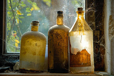 Old And Dusty Glass Bottles Print by Matthias Hauser