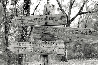 Old Directional Signs At Fort Cooper  Print by Debra Forand