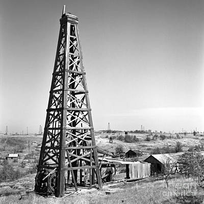 Black And White Photograph - Old Wooden Derrick by Larry Keahey
