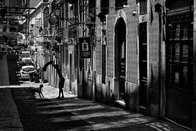 Lively Photograph - One Man And His Dog. Bairro Alto. Lisbon by Carol Japp