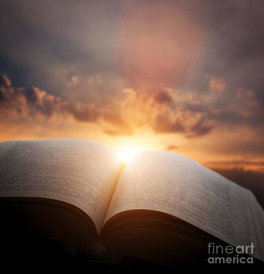 Book Photograph - Open Old Book With Light From Sunset Sky by Michal Bednarek