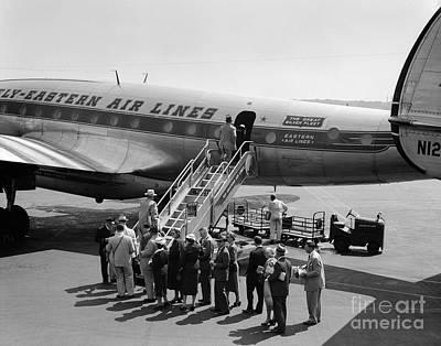 Passenger Plane Photograph - Passengers Boarding A Flight by C.S. Bauer/ClassicStock
