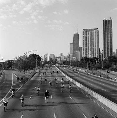 People Cycling On A Road, Bike The Print by Panoramic Images