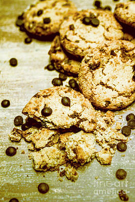 Pile Of Crumbled Chocolate Chip Cookies On Table Print by Jorgo Photography - Wall Art Gallery
