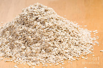 Porridge Photograph - Pile Of Dried Rolled Oat Flakes Spilled  by Arletta Cwalina