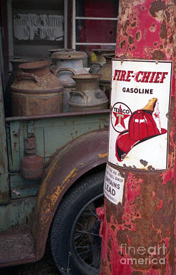 Old Milk Jugs Photograph - Pit Stop by Richard Rizzo
