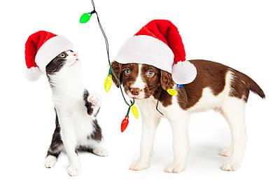 Playful Christmas Kitten And Puppy Print by Susan  Schmitz