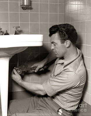 Bathroom Sinks Photograph - Plumber Fixing Bathroom Sink, C.1950s by H. Armstrong Roberts/ClassicStock